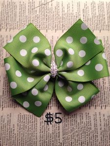 Green polka dotted pinwheel bow