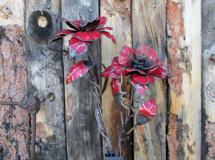 red metal flower - ruff cut wood and metal