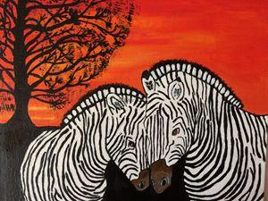 Zebras in sunset