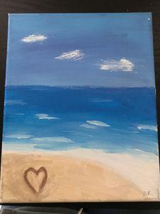 Ocean heart written in sand