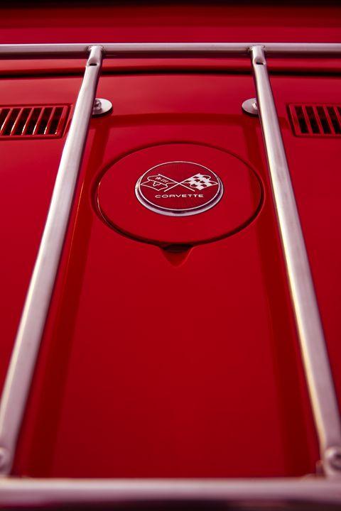 Red Corvette gas tank emblem - Felix Padrosa