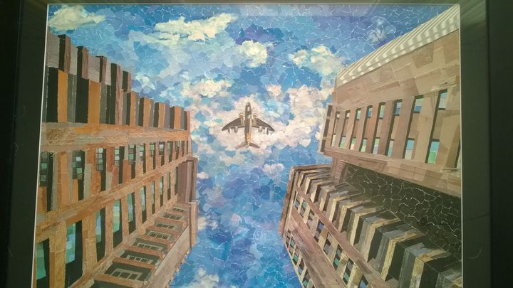 airplane over city - My gallery