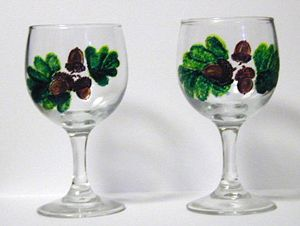 acorns painted on wine glass