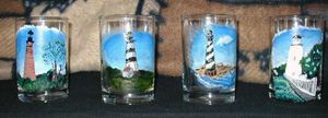 lighthouses on whiskey glasses