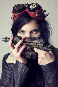 Girl with steampunk gun