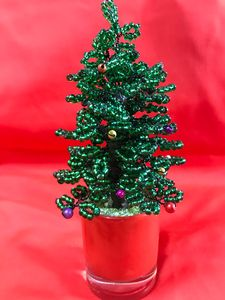 Christmas bonsai tree in a glass