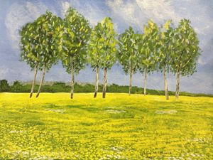 Trees in the dandelion field
