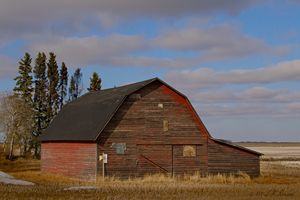 Red Barn on Blue Prairie Sky