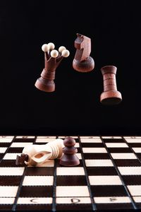 Chess pieces levitate over the chess