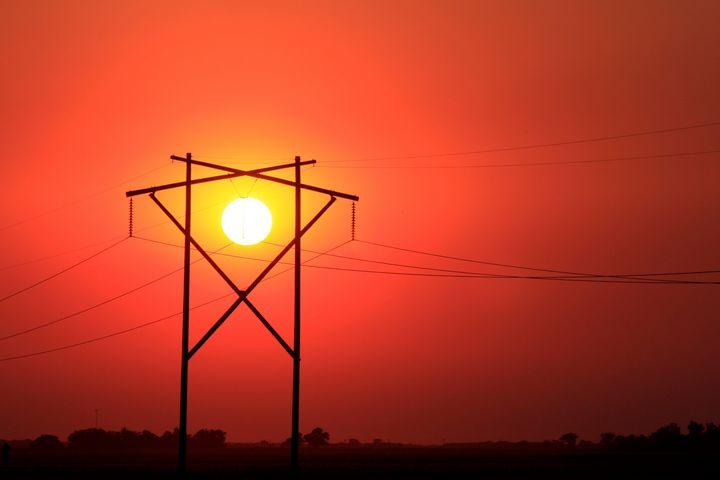 Kansas Blazing Red Sunset with Sun - Robert D Brozek