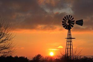 Kansas Golden Sunset With Windmill