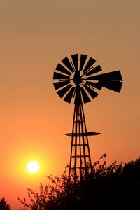 Kansas Windmill with an orange sky.
