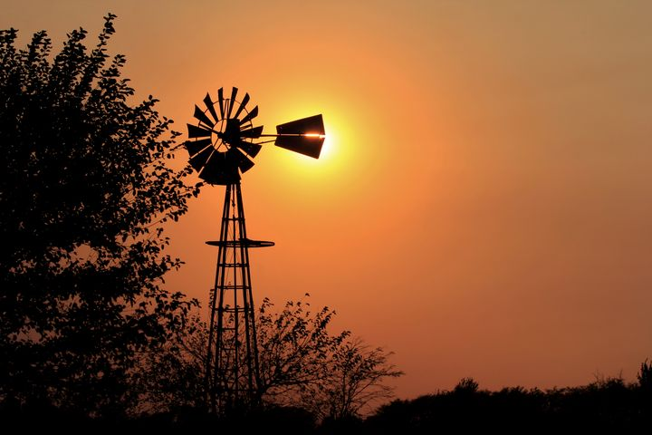 Kansas Golden sky with a Windmill - Robert D Brozek