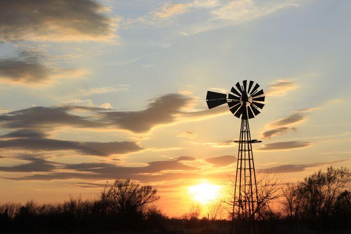 Kansas Windmill silhouette Sunset. - Robert D Brozek