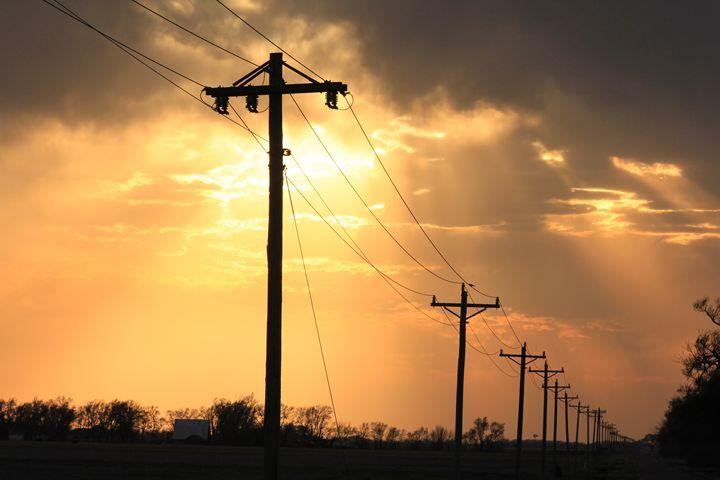 Kansas Sunset with Telephone Poles - Robert D Brozek