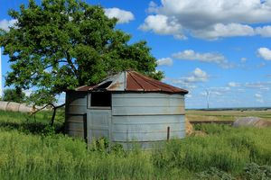 Old Metal Grain Bin with blue sky