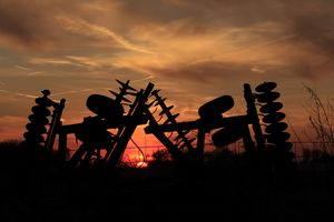 Sunset with farm Equipment and fence