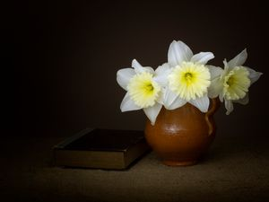 Vintage style daffodils with book