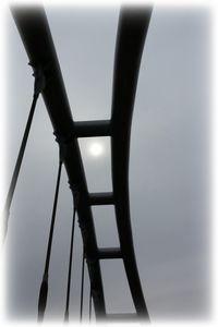 White sun over the bridge