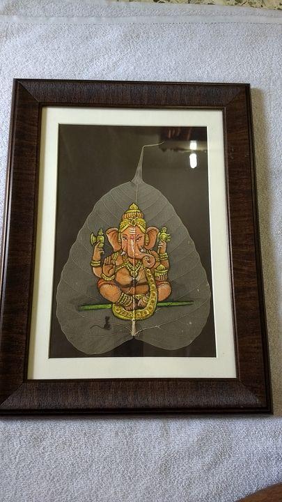 Golden chaturbhuj ganesha - Ganesha on peepal leaf